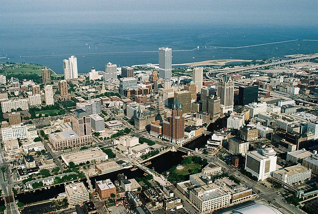 Aerial view of downtown Milwaukee, WI, with Lake Michigan in the background.