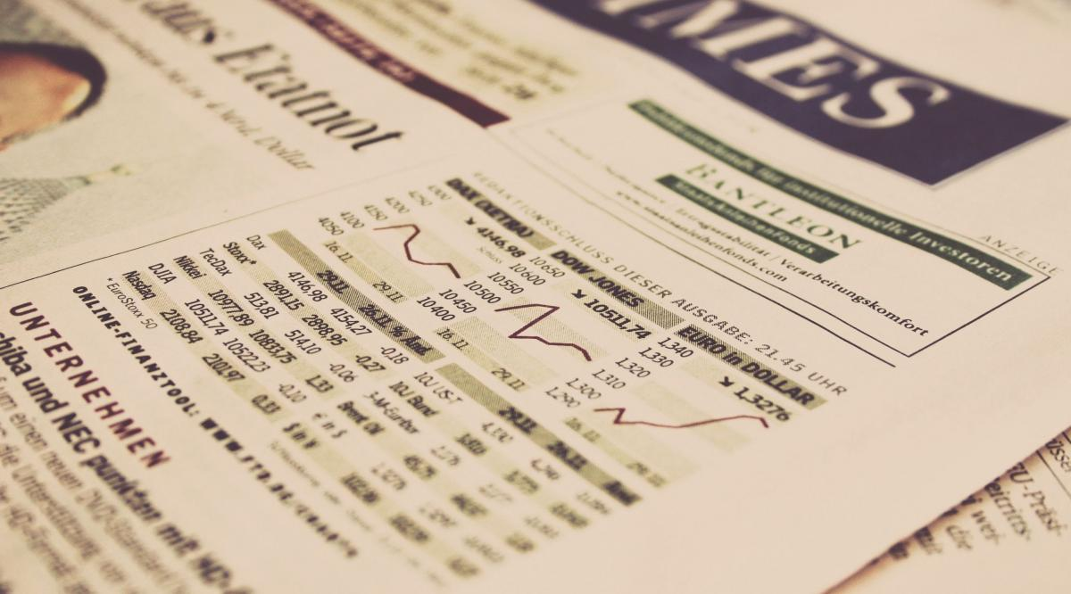 A newspaper page with graphs and charts for the stock market.
